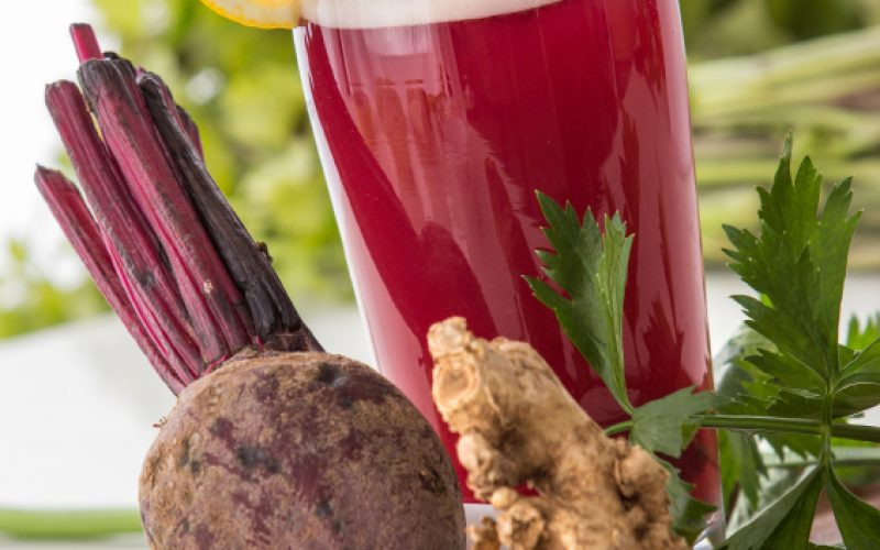a potrait of a glass beet and herbs mix into a refreshing juice